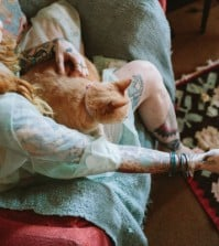 woman with cat and coffee