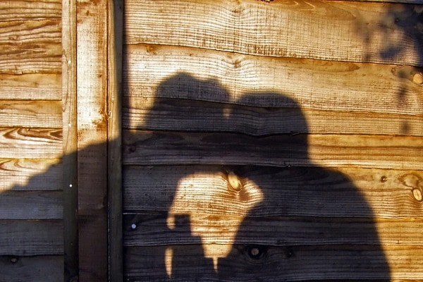 happy couple kissing in shadow