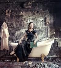 woman sitting on bathtub