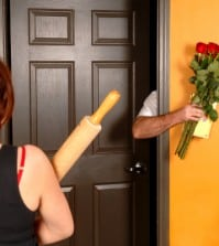 angry woman not letting man come through door